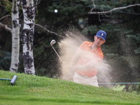 Canadian golfer Mike Weir hits balls out of a sand trap while practising during the ProAm Day at the Shaw Charity Classic in Calgary, Alberta, on August 11, 2021. Todd Korol/Shaw Charity Classic