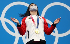 A joyous Maggie Mac Neil of London reacts after getting the gold medal for the women's 100m butterfly at the Tokyo Olympics. It was Canada's first gold of the Games. (REUTERS/Kai Pfaffenbach)