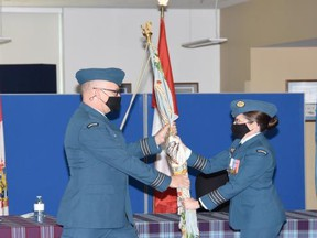 Colonel M.C.G. Lehoux (R) hands the 434 Squadron colours to incoming commanding officier LCol Matthew Parsons (L). SUBMITTED PHOTO