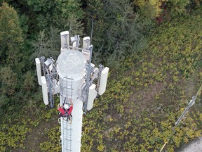 A worker climbs a Rogers Communications tower. The company's expansion of its 5G mobile service now includes Quinte West. Rogers Communications