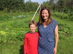 Family Earth founder Rochelle Johnston, with her nine-year-old son Kai, at the ecological market garden. Photo on Friday, August 13, 2021, in Gallingertown, Ont. Todd Hambleton/Cornwall Standard-Freeholder/Postmedia Network