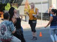 Yafa Goawily (second from left) and friends performing on Pitt St. at Cornwall Art Walk. Photo on Friday, August 27, 2021, in Cornwall, Ont. Todd Hambleton/Cornwall Standard-Freeholder/Postmedia Network