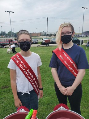 Due to the ongoing COVID-19 pandemic the Hanover Fair was unable to hold the Ambassador of the Fair Competition this year, so the 2019-20 ambassadors graciously agreed to extend their reign. Pictured are L'il Ambassador Claire Olivero, left, and Junior Ambassador Jacinta Paterson. Absent from the photo is Senior Ambassador Olivia Schlosser. This year's fair, from Aug. 5-7, was once again held virtually due to the pandemic, however, there were some opportunities for in-person gatherings with some of the activities.