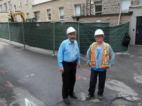 Tony O'Loughlin, president of the Kingston Irish Famine Commemoration Association, and ASI Heritage archeologist Katherine Hull at the site of the Irish burial site at Kingston General Hospital.