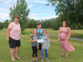 Lorrie O'Connor is with the Byers children and Emily Lamarche of L & E Industrial Laundry who's company made a generous donation which will assist the local Jr. Golf program.
