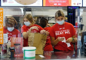 """Staff at Kenora's A&W spend some time preparing orders on """"Burgers to Beat MS Day"""" on Thursday, Aug. 19. The local fast food chain raised $37,850.81 for multiple sclerosis."""