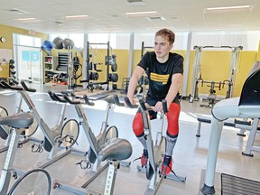 Russian import Matvey Petrov of the North Bay Battalion works on an exercise bicycle. He was the No. 1 pick in the 2020 Canadian Hockey League Import Draft. Submitted Photo