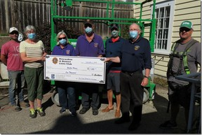 Flanked by Bird Construction workers, Lion President Paul Thompson presents a cheque to Sylvia Leigh, fundraising chair, of the ongoing Walker House restoration project. Lions Joan Thompson, Larry Bannerman and Peter Morris assist. SUBMITTED