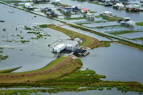 """This photo obtained on September 6, 2021 courtesy of the US Army shows an aerial view of damage left by Hurricane Ida in southeastern Louisiana on September 1, 2021. - The US Army Corps of Engineers conducts aerial assessments to gain a better understanding of the size and scope of the damage, and to help determine capabilities and support USACE can provide in the ongoing response effort. (Photo by Grace GEIGER / US ARMY / AFP) / RESTRICTED TO EDITORIAL USE - MANDATORY CREDIT """"AFP PHOTO /US ARMY/GRACE GEIGER/HANDOUT """" - NO MARKETING - NO ADVERTISING CAMPAIGNS - DISTRIBUTED AS A SERVICE TO CLIENTS (Photo by GRACE GEIGER/US ARMY/AFP via Getty Images)"""