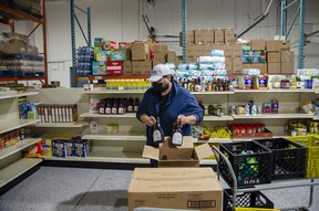 Benjamin Mailloux sorts food donations at the Wood Buffalo Food Bank, on Wednesday, September 8, 2021. Scott McLean/Fort McMurray Today/Postmedia Network