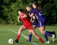 Chatham Strikers' Jillian Hyatt, left, is chased by Alliance Crush's Lauren Duff and Krystal Shaw in a London & Area Women's Soccer League game at St. Clair College's Chatham campus field in Chatham, Ont., on Wednesday, Sept. 1, 2021. Mark Malone/Chatham Daily News/Postmedia Network