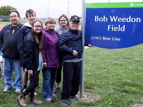 Bob Weedon, right, is joined by daughter Kathy Szymanski, wife Sylvia Weedon, granddaughter Rachel Szymanski, grandson Brendan Szymanski and son-in-law Mark Szymanski at a naming ceremony for Bob Weedon Field at St. Clair College in Chatham, Ont., on Thursday, Sept. 23, 2021. Mark Malone/Chatham Daily News/Postmedia Network