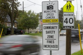 Signs in front of Princess Elizabeth public school on Thompson Road in London warn drivers that photo radar is on the way. The first two cameras in the city's new system are being set up at Princess Elizabeth and on Second Street near F.D. Roosevelt elementary school. The city's goal is to reduce speeds in school zones, where the speed limit is 40 km/h. (Mike Hensen/The London Free Press)
