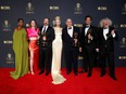"""Actors Moses Ingram, Marielle Heller and Anya Taylor-Joy pose for a picture along with producers Scott Frank, Allan Scott, Mick Ancieto and Marcus Loges, with their awards for """"The Queen's Gambit"""", at the 73rd Primetime Emmy Awards in Los Angeles, September 19, 2021."""