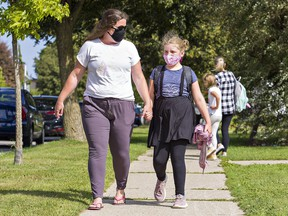 Jessica Hill walks with her nine-year-old daughter, Alexis Lowes, at the end of the school day on Tuesday in Brantford, Ontario. Alexis started Grade 4 at Branlyn School.