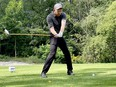 Mitch Beattie tees off on the first hole of the Friends of Palliative Care Golf Days on Tuesday. (MARSHALL HEALEY/The Recorder and Times)