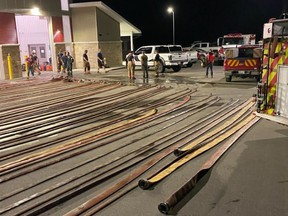 Augusta firefighters clean the many hoses used during a fire call near Stones Corners on Tuesday. Submitted photo/The Recorder and Times