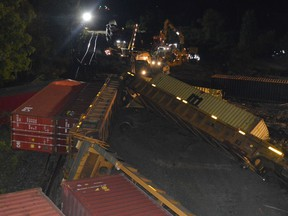 Crews continue clean-up operations at the derailment site just west of the Edward Street overpass in Prescott early Friday morning. Tim Ruhnke/The Recorder and Times
