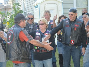 Bob Campbell of the All Round Charity (ARC) riding club in Prescott and Mike Berthiaume of the Legion Riders in Cornwall shake hands after an ARC ride on Saturday that raised more than $4,700 for homeless veterans in the region. Tim Ruhnke/The Recorder and Times