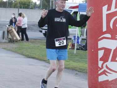 Octogenarian John Sheehan from Cardinal crosses the finish line at the Twilight Fun Run in Johnstown. Tim Ruhnke/The Recorder and Times