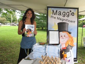 Children's book author Erin Lee, holding a copy of Out of Season, her second published book, at a vendor's market on the weekend in Long Sault. Photo on Saturday, September 11, 2021, in Long Sault, Ont. Todd Hambleton/Cornwall Standard-Freeholder/Postmedia Network
