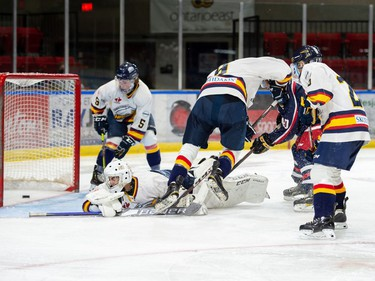 Hawkesbury Hawks goaltender Dimitri Pelekos eyes the puck over the goal line during exhibition play against the Cornwall Colts on Thursday September 9, 2021 in Cornwall, Ont. Cornwall won 4-3 in OT. Robert Lefebvre/Special to the Cornwall Standard-Freeholder/Postmedia Network