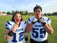 Alicia Gladue (left) is the only girl to play on the Saints football team in Fort McMurray. At a practice, she has a red handprint over her face to acknowledge MMIW. Supplied image
