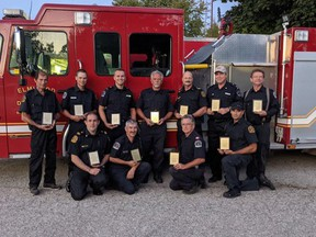 The Elmwood Fire Department hosted their service awards ceremony on Sept. 15. Pictured here are members who were recognized for their years of service. Top row: John Becker (40 years), Erich Stutzki (10 years), Luc Lang (10 years), Alf Brenndorfer (45 years), Doug Cowell (10 years), Rick Moore  (5 years), Hannes Aasa (5 years). Botom row: Tim Olds (15 years), Alex Dennie (20 years), Perry McKnight, 18 years, retired member), and Ryan Brunner (15 years). Missing from the photo is Chris Brunner.
