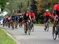 Ride to Remember participants pass by City Park in Kingston on Friday.