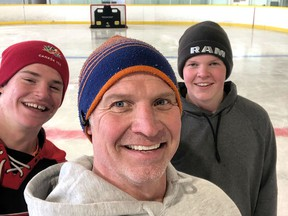 Former Kingston Frontenac Dave Stewart with his sons, current Frontenac Jackson, left and Rowan at their home arena in Norwood, Ontario in an undated file photo.