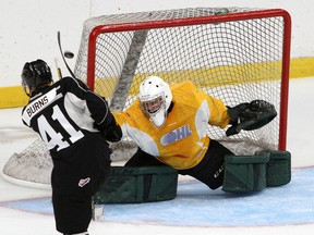 Kingston Frontenacs rookie defenceman Quinton Burns shoots wide on rookie goaltender Mason Vaccari during a scrimmage at the Leon's Centre on Wednesday Sept. 1.