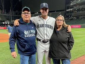 Kingston's Matt Brash of the Seattle Mariners with his parents, Jamie and Sandra, at T-Mobile Park in Seattle on Tuesday, Sept. 28, 2021, after Brash was called up to the major-league club prior to its game against the Oakland Athletics.