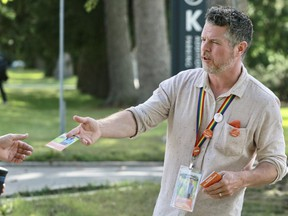 Kevin Kruchkywich, the federal NDP candidate for Perth-Wellington, hands out campaign material on Wednesday, Sept. 8, near Stratford General Hospital in Stratford, Ont.   Cory Smith/Stratford Beacon Herald/Postmedia Network
