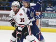 Sudbury Wolves Cole Mayo keeps in close check with Niagara IceDogs  Mitchell Fitzmorris  in Sudbury, Ont. on Tuesday March 3, 2015.