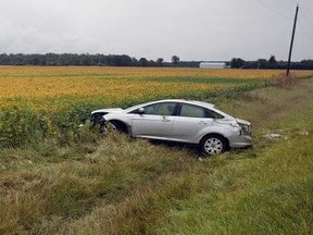 Three people were rushed to hospital and the driver was charged after a single-car rollover on Oil Heritage Road north of Michigan Line on Thursday, Sept. 9, 2021, Lambton OPP say. (Lambton OPP)