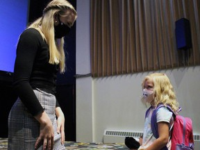 Lilly Bartlam, who voices the character Skye in PAW Patrol: The Movie, greets five-year-old Forest resident Mia Treamine inside the Kineto Theatre on Saturday September 11, 2021 in Forest, Ont. Terry Bridge/Sarnia Observer/Postmedia Network