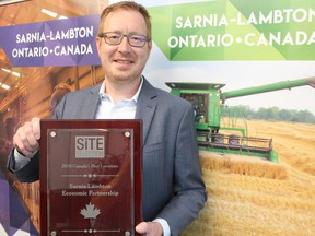 Stephen Thompson, CEO of the Sarnia-Lambton Economic Partnership, holds a previous award the agency received for being named one of Canada's Best Locations by Site Selector magazine. The agency made the list again recently, for the fourth year in a row.