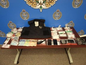This photo provided by Sarnia police shows drugs and other items allegedly seized Tuesday by officers with a search warrant for an address on Devine Street.
