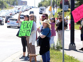 Protesters gather on Paris Street in front of Health Sciences North and Public Health Sudbury and Districts on Wednesday, September 1, 2021, for a Rally for Medical Freedom to show their opposition to COVID-19 vaccine mandates and other restrictions. Ontario government officials announced on Wednesday that, effective Sept. 22, proof of vaccination will be required to attend many indoor businesses and facillities. Ben Leeson/The Sudbury Star/Postmedia Network