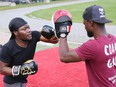 Fitness trainer Gaby Onadja, right, encourages Yung Kabc during a round of fitness boxing at Queen's Athletic Field in Sudbury, Ont. on Wednesday September 15, 2021. John Lappa/Sudbury Star/Postmedia Network