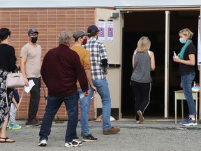 People line-up to vote in the federal election at Walden Public School in Lively, Ont. on Monday September 20, 2021. John Lappa/Sudbury Star/Postmedia Network