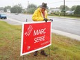 Volunteer Jacques Guy removes an election sign from a lawn in Garson, Ont. on Tuesday September 21, 2021. John Lappa/Sudbury Star/Postmedia Network