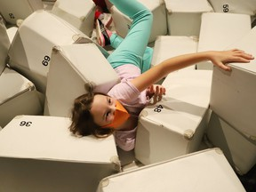Abigail Rickford, 8, daughter of Greg Rickford, Minister of Northern Development, Mines, Natural Resources and Forestry and Minister of Indigenous Affairs, explores the Indigenous Ingenuity exhibit at Science North in Sudbury, Ont. on Friday September 24, 2021. John Lappa/Sudbury Star/Postmedia Network