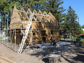 A new log cabin is under construction near the entrance to the Children's Animal Farm in Sarnia's Canatara Park. Paul Morden/Postmedia Network