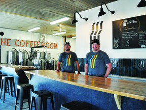 Nine in a line Brewery Co. co-owners Dan Anderson, left, and Dave Markert opened their brewery at 119 First Ave. N. last week.