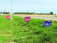 Election signs along Highway 23.