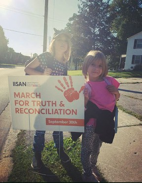 Fae and Rune Marshal, the two daughers of organizer Patricia Marshal, help get ready for Thursday's march on the National Day of Truth and Reconcilation. SUBMITTED PHOTO