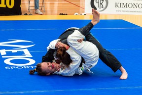 Hanover's Megan Kuntz (white Gi) applies a triangle choke during her division's final match at the 2021 GTA Classic at the Markham Pan Am Centre. Kuntz, one of 11 athletes from Kilian Academy in Owen Sound represented at the Brazilian Jiu-Jitsu tournament this past weekend, won a silver medal. Photo supplied.