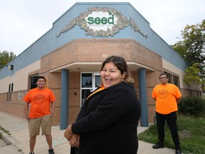 Money Stories facilitators Justin Huntinghawk, Calandra Necan, and Andrew Proulx-Courchesne (from left) pose in front of the SEED Winnipeg office on Salter Street on Thursday, Sept. 2, 2021.
