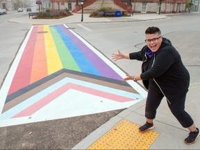Sirkel Foods owner Kelly Ballantyne enjoys Stratford's first progress pride crosswalk. Ballantyne advocated for the crosswalk, completed near city hall over two days this week, with local group Stratford-Perth Pride. A number of community partners, including local companies Magest Building Systems Limited and Powerhouse Painting, helped make the project a reality. Chris Montanini/Stratford Beacon Herald